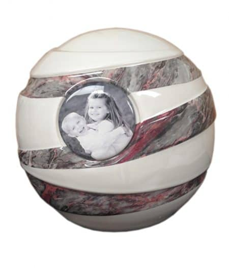 A ceramic urn with a picture to remember your loved one