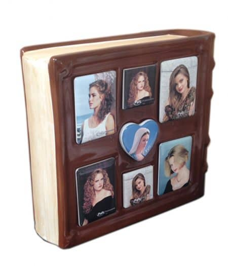 A bound book styled ceramic urn to store your loved ones ashes and lovely memories in pictures