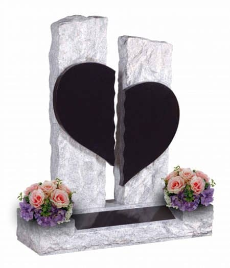 Black and grey headstone with love heart and flower arrangement.