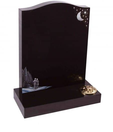 A simple black marble headstone with a couple under a crescent moon