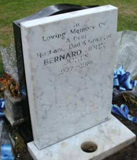 A weathered and faded headstone, just before our master carvers re-carved the inscription and cleaned up the headstone.