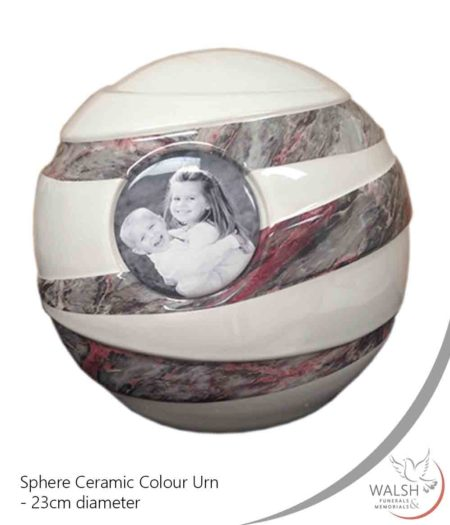 A spherical ceramic urn with a picture to remember your loved one
