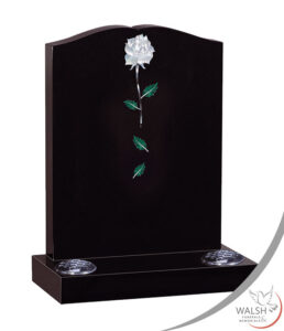 Black granite headstone memorial with white rose and leaves